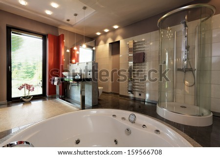 Luxury bathroom with bath and glass shower - stock photo