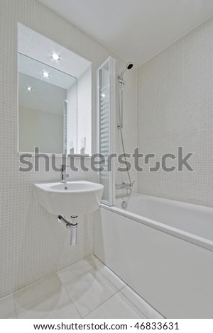 luxury bathroom with beige mosaic tiles and modern appliances - stock photo