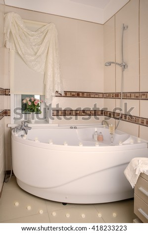 Luxury bathroom with candles and flowers