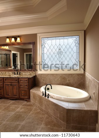 Luxury Bathroom with tub and Stained Glass
