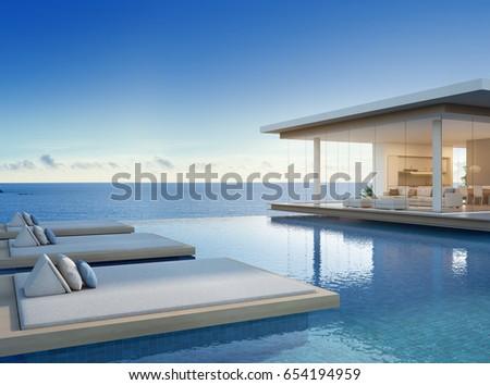 Luxury beach house sea view swimmingภาพประกอบสต็อก 654194959
