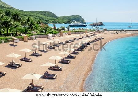 Luxury beach near the island Sveti Stefan in Montenegro - stock photo