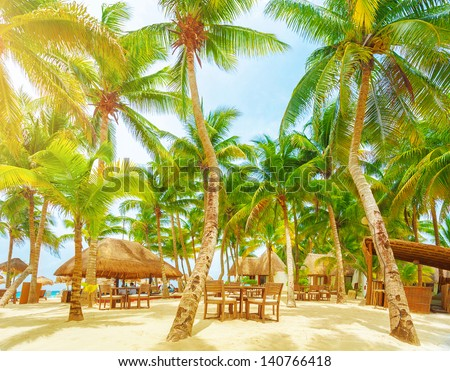 Luxury beach resort, romantic island in Atlantic ocean, comfortable bungalow, palm trees, cozy cafe on sandy seashore, summer holiday and vacation concept - stock photo