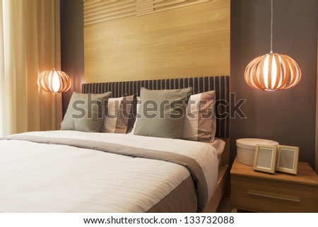 luxury bedroom decorated with wood. - stock photo