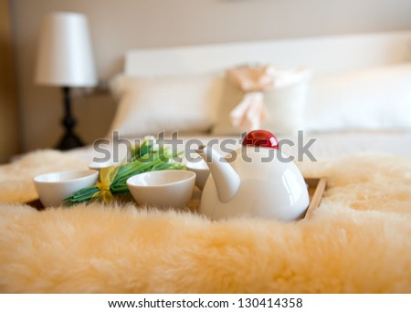 luxury bedroom interior with beverage on bed. - stock photo