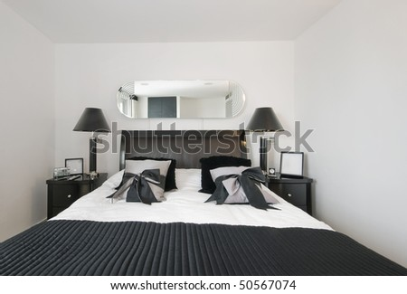 luxury bedroom with loads of accessory and designer furniture - stock photo
