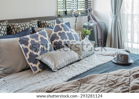 luxury bedroom with pillows on bed at home - stock photo