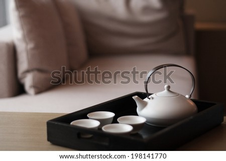 luxury bedroom with tea set. - stock photo