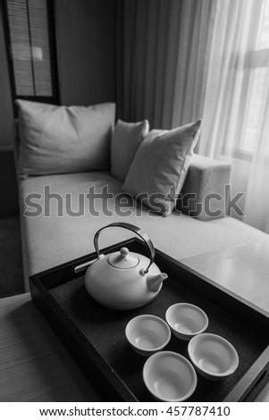 luxury bedroom with tea set. - stock photo