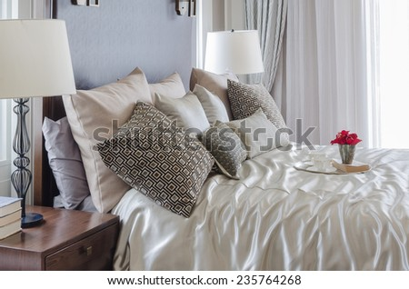 luxury bedroom with tray of flower on bed - stock photo