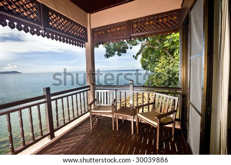 Luxury bedroom with view of sea. Ecotourism. - stock photo