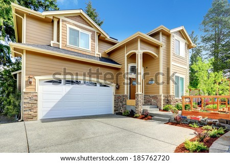 Luxury big house with garage and high column entrance porch. - stock photo
