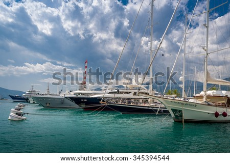 Luxury big motor and sailing yachts moored at Tivat old town marina. Mediterranean, Montenegro. - stock photo