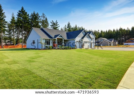 Luxury blue house with curb appeal and well kept lawn. Northwest, USA