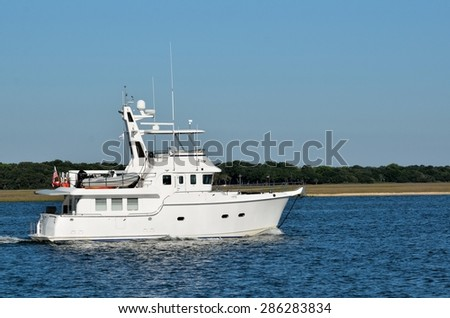 Luxury boat cruising on along the river at Florida, USA. - stock photo