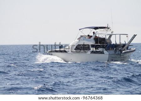 Luxury boat with horizon line in Montenegro - stock photo