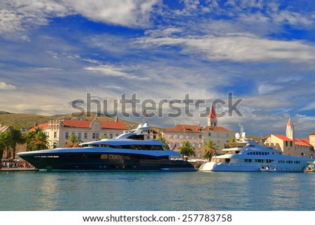 Luxury boats tied to the pier of old Venetian town, Trogir, Croatia - stock photo