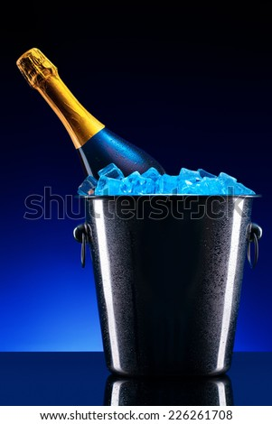 luxury bottle of champagne in Metal ice bucket with ice cubes