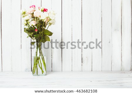 Luxury bouquet of roses lying over wooden wall. Copy space