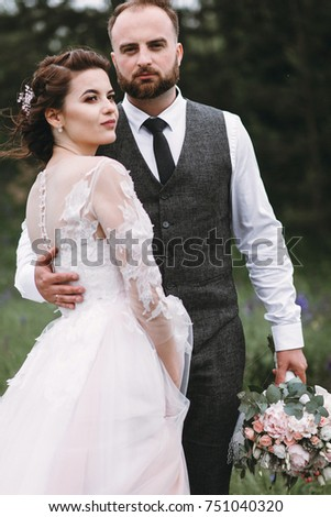 Luxury Bride And Groom With A Beard Walk On Their Wedding Day In Place Near