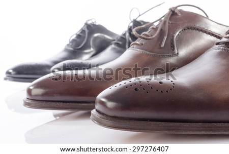 Luxury brown and black shoes, isolated on white