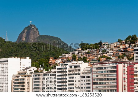 Luxury Buildings in Front of the Copacabana Beach with Corcovado Mountain Behind in Rio de Janeiro, Brazil - stock photo