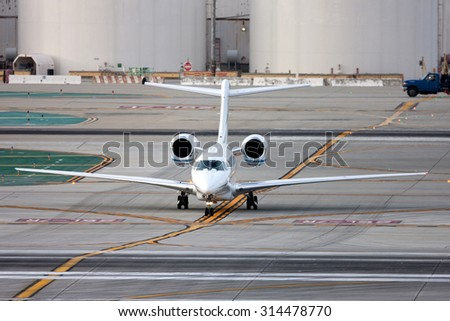 Luxury Business Aircraft Taxiing after landing - stock photo