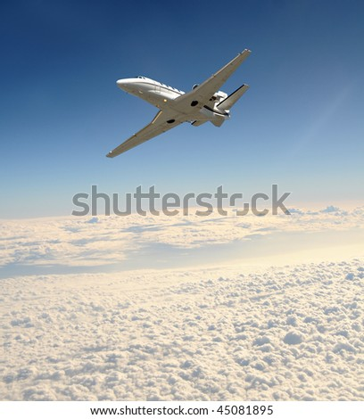 Luxury business jet flying at high altitude - stock photo