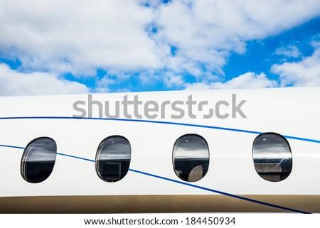 Luxury Business Private Jet plane windows raw - stock photo