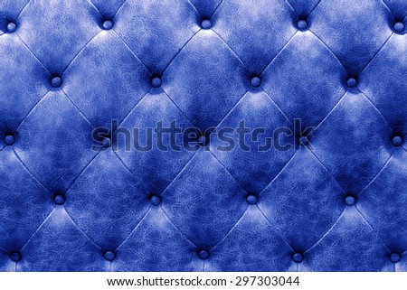 luxury buttoned blue leather background - stock photo