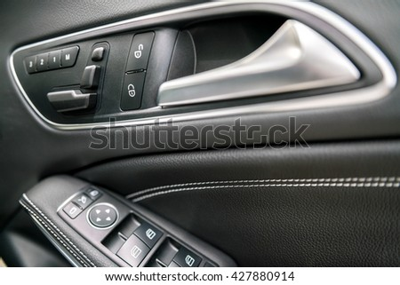 luxury car control buttons - door panel ; Interior details.   - stock photo