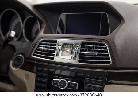 Luxury car dashboard. Interior detail. - stock photo