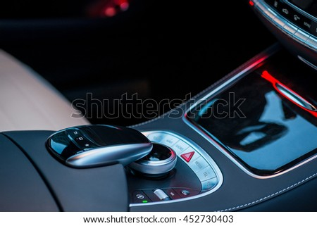 Luxury car interior details. Middle console with gearbox controls