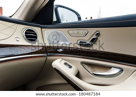 Luxury car interior details. Skin and chromium. - stock photo