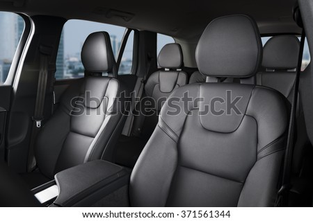 Luxury car interior view, black leather car seats - stock photo