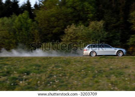 Luxury Car on the Move - stock photo