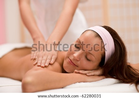 Luxury care - woman at back massage in spa center