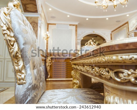 Luxury chairs and table in gilt, interior luxury. - stock photo