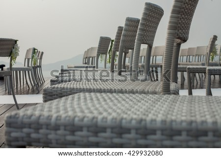 Luxury chairs setup for outdoor wedding  ceremony . - stock photo