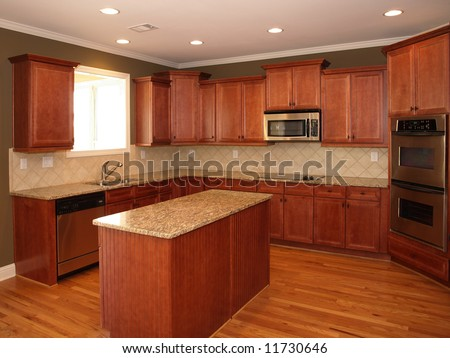 Luxury Cherry Wood Kitchen with Marble Island - stock photo