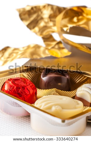 Luxury chocolates unwrapped from the gift box - stock photo