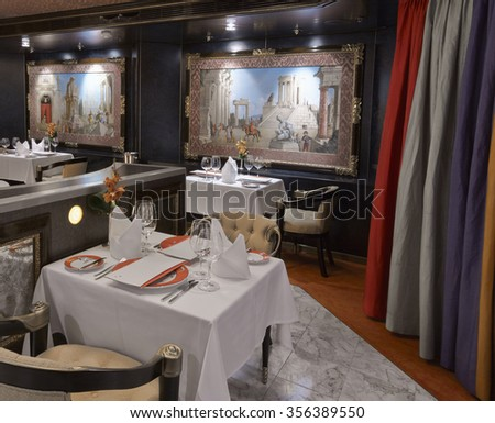 Luxury classic restaurant with beautiful table setting - stock photo