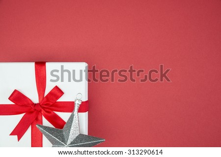 luxury color gift box for holiday event silk wrap snowflake on red background isolated