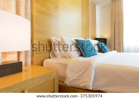 luxury contemporary bedroom decorated with wood. - stock photo