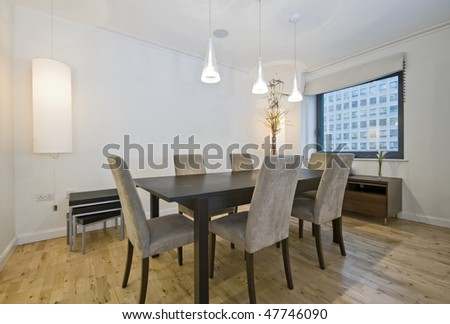 luxury contemporary dining room with hard wood table and six seats - stock photo