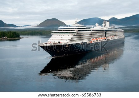 luxury cruise liner arriving in alaskan port of call on cloudy morning