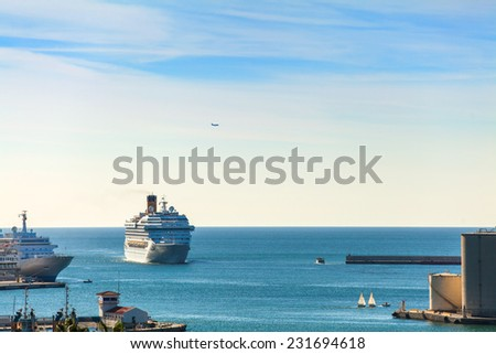 Luxury cruise ship arriving at port. - stock photo