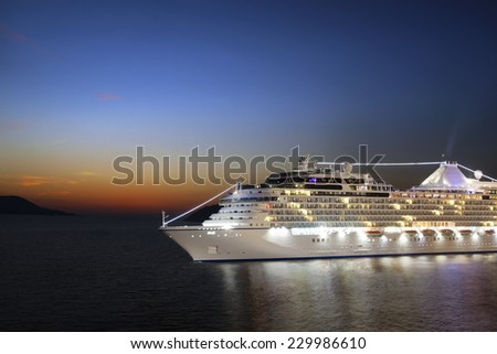 Luxury cruise ship sailing to port on sunrise  - stock photo