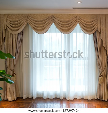 Luxury curtain with a copy-space in the middle - stock photo