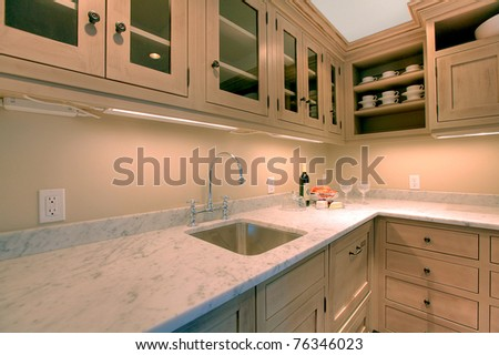 Luxury custom build small kitchen in the basement room for entertainment. - stock photo